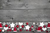 foto of xmas star  - Christmas decoration border on grey wooden background - JPG