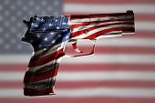 image of handgun  - Handgun and American flag composite - JPG