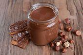 picture of chocolate fudge  - Sweet chocolate cream in jar on table close - JPG