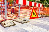 pic of reconstruction  - Road signs in a street under reconstruction symbol - JPG