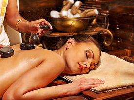 stock photo of panchakarma  - Young woman having Ayurveda stone massage - JPG