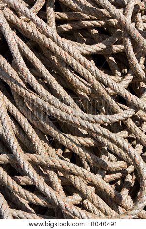 Background Image Of Coiled, Used Rope