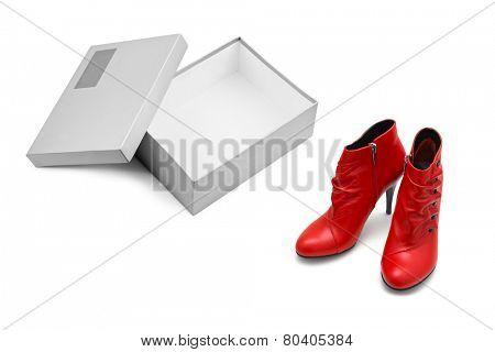 Red shoes and open box isolated on white background