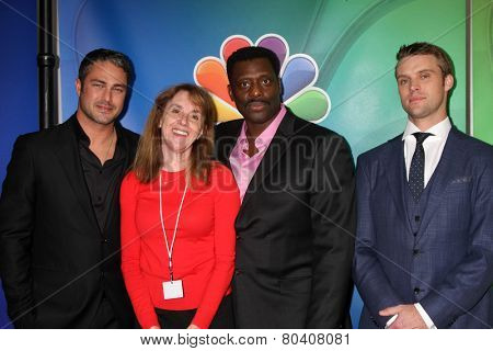LOS ANGELES - DEC 16:  Taylor Kinney, Pam Golum, Eamonn Walker, Jesse Spencer at the NBCUniversal TCA Press Tour at the Huntington Langham Hotel on December 16, 2015 in Pasadena, CA