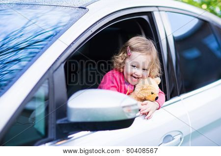 Little Girl In A Car