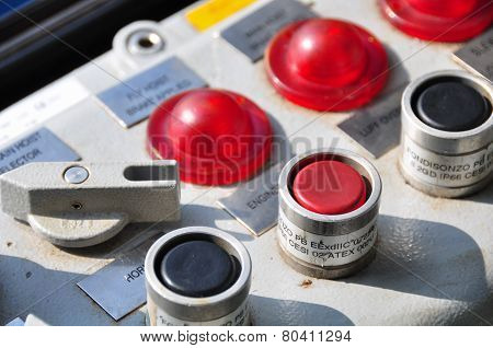 Closeup of control dials on manufacturing machinery or selector switch on control room.