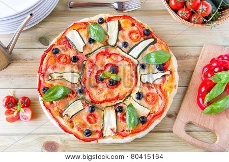 Italian Pizza With Black Olives, Cherry Tomatoes, Eggplants And Peppers