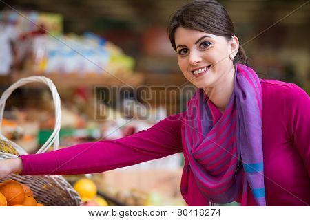 Beautiful Young Woman Shopping In A Grocery Supermarket