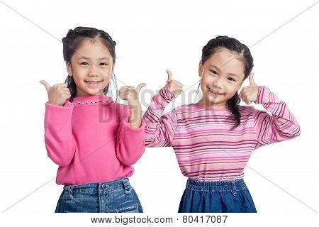 Asian Twin Sisters Show Thumbs Up