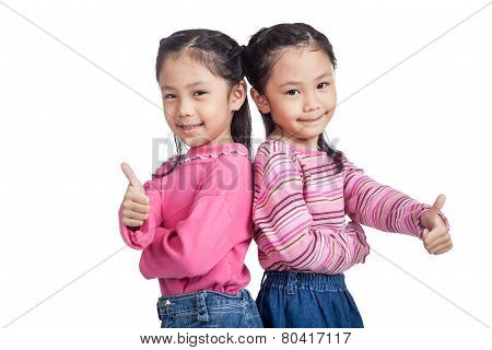Asian Twin Sisters Thumbs Up  Standing Back To Back