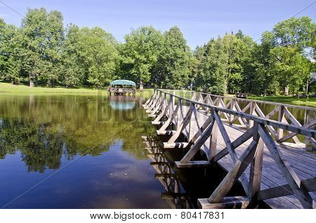 Wooden Brigde On Resort Lake Water