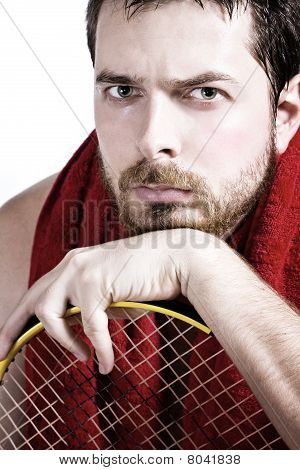 Portrait Of Tired Male Tennis Player