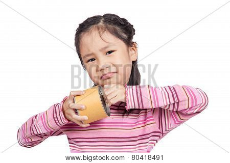 Asian little girl cannot open a can