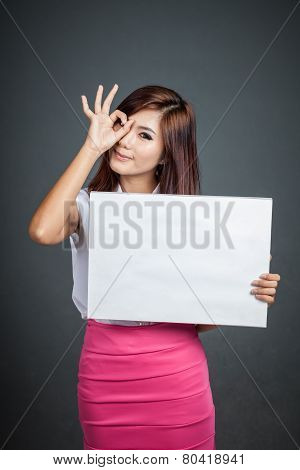 Asian Girl Hold Blank Sign Show Ok Sign At Her Eye