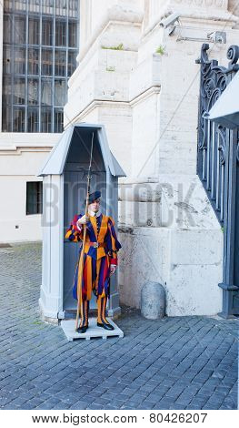 unidentified Papal Swiss guard standing at the Vatican Museums door in the Vatican