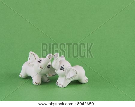 Two small white baby elephant figurines