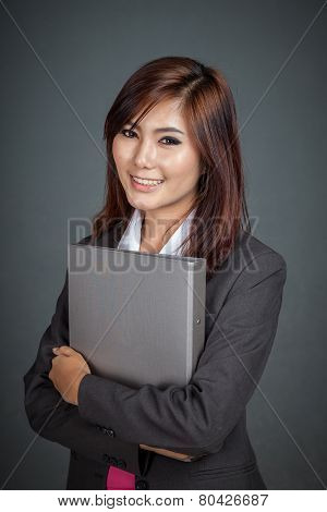 Happy Asian Businesswoman Hold A Folder