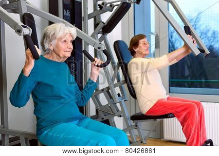 Senior Women Doing Chest Press Exercise