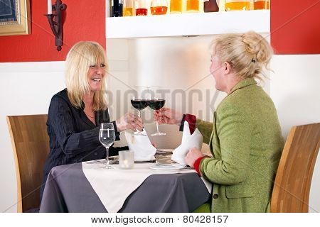 Two Female Friends Enjoy A Relaxing Drink