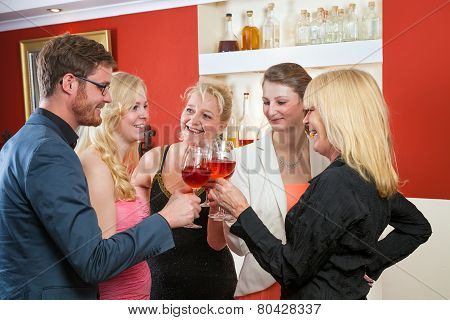 Group Of Friends Celebrating With Rose Wine