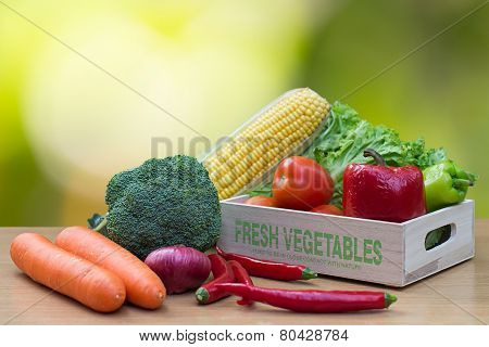Variety Of Fresh Vegetables In Wooden Box On Wood Table