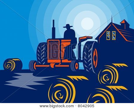 Farmer driving vintage tractor with hay bales