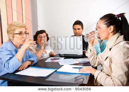 All Business People Drinking  Water At Meeting