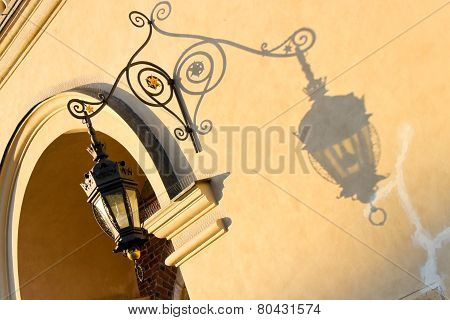 Wrought-iron Lantern  Casts A Shadow On A Wall