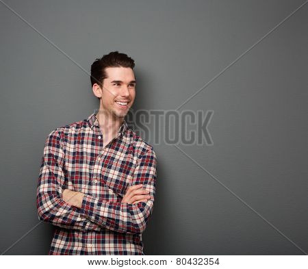 Cool Guy Smiling With Arms Crossed