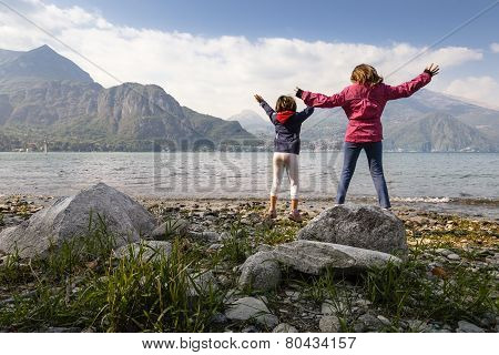 Kids Jumping Near The Lake