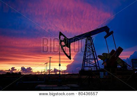 Oil Derricks On A Background Of Beautiful Sunset