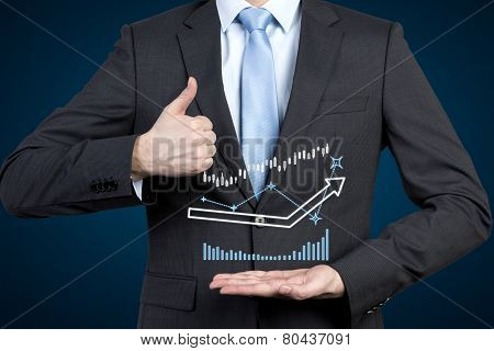 Businessman Holding Charts