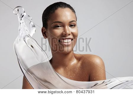 Woman With A Wet Skin And A Splash Of A Water