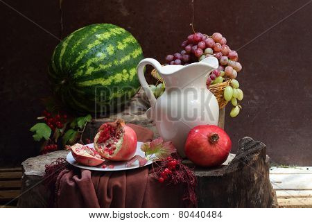 Wine, Grapes, A Pomegranate And A Water-melon