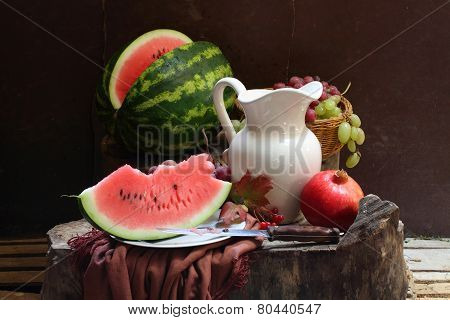 Grapes, A Pomegranate, A Water-melon And A White Jug