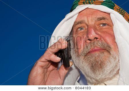 Handsome Senior Arab On The Phone