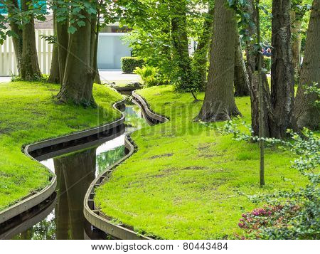 Small winding canal in park