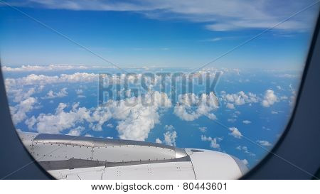 View from airplane window, Top view from airplane, Clouds on the sky and view from airplane window.