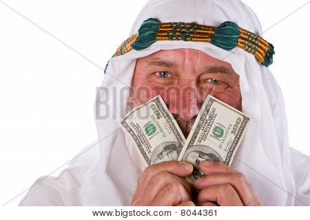 Arab Male Holding Money To His Face