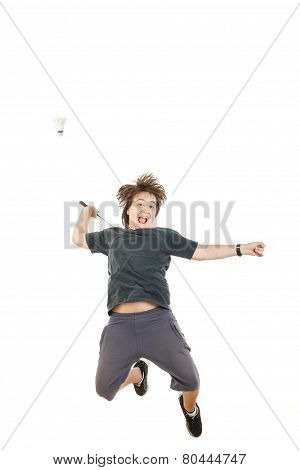 Boy Smiling And Holding Badminton Racket And Trying To Hit Ball