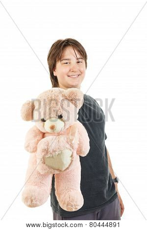 Boy Smiling And Holding Teddy Bear Toy As Gift For Girl