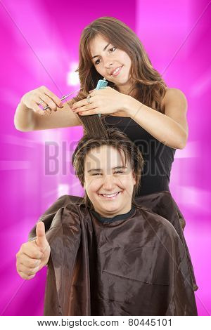 Boy Smiling With Long Hair With Thumb Up At Happy Female Hairdresser