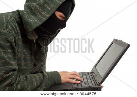 criminal in balaclava with laptop