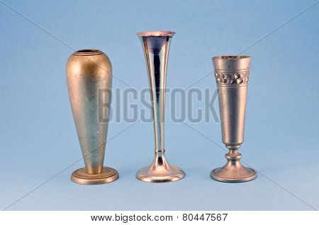Three Antique Metal Silver Goblet Cup On Blue Background