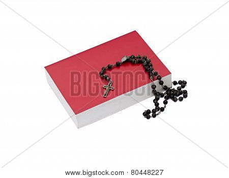Bible And Rosary On A White Background