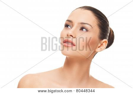 Beautiful Face Of Young Woman With Clean Skin On A White Background