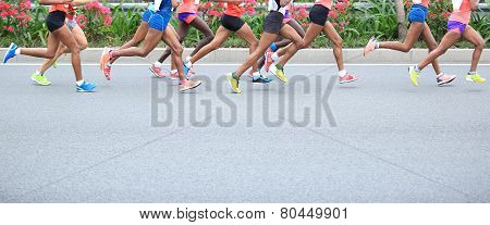 Marathon running race, people feet on city road