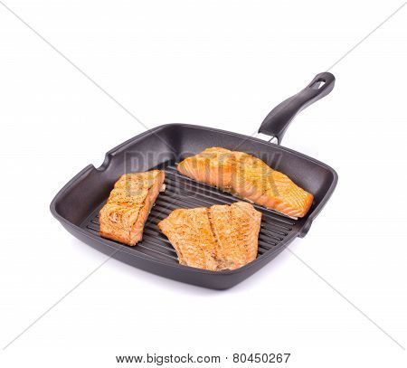 Salmon in pan.