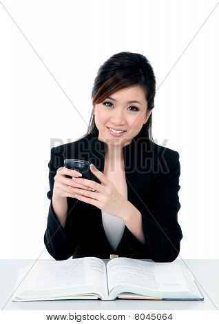Happy Young Businesswoman Holding Mobile Phone