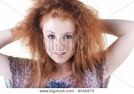 Portrait Of Red-haired Smiling Girl.